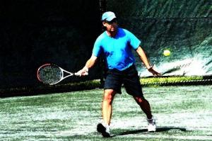Mark playing tennis at WTC 2013